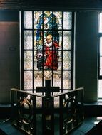 stained glass window depicting a saint on the cathedral