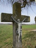 ancient stone Wayside Cross at countryside, germany. bavaria