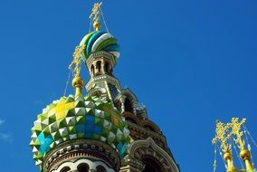 Golden crosses on the colorful domes of the church in St. Petersburg