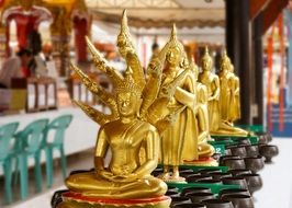 golden buddhas in asian temple