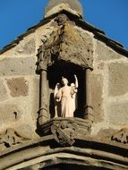 angel, Statue on facade at top of gothic Church, france, Auverge
