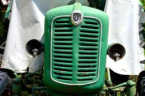 old green tractor close-up