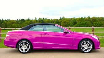 side view of a luxurious pink Mercedes