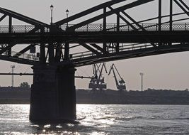 bridge over the Danube river against the background of port cranes in Slovakia