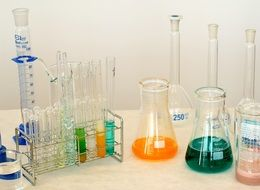 colorful liquids in test tubes on the table