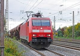red freight train on the railway