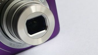 purple camera lens on a white table