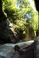 panoramic view of a stormy river in Partnachklamm gorge on a sunny day