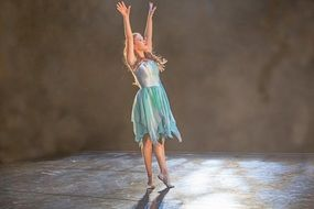 girl in a ballet dress on stage