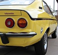 rear view of a yellow classic car