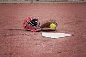 helmet and glove on a field in softball