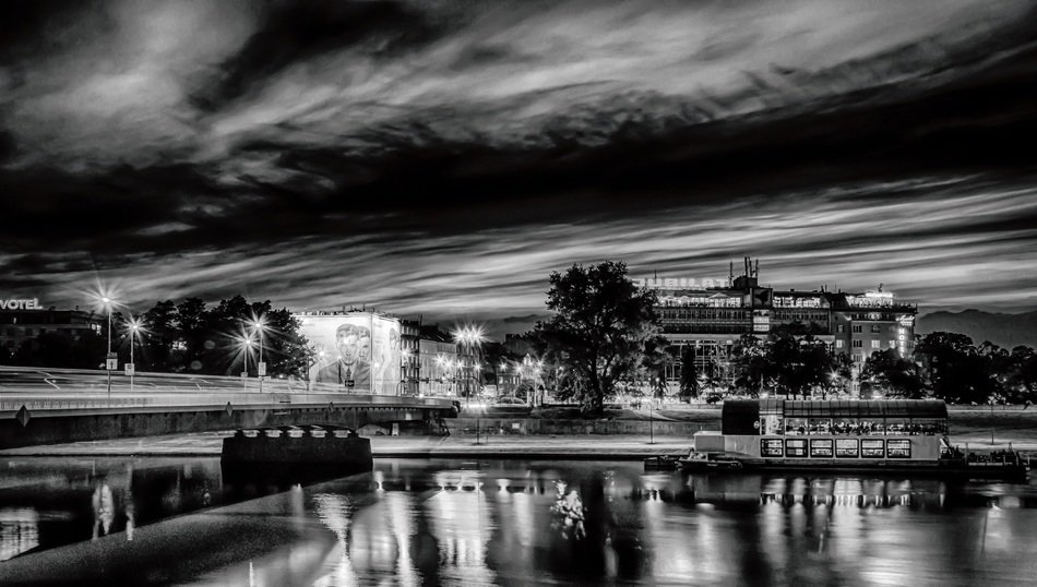 black and white panoramic view of krakow at dusk
