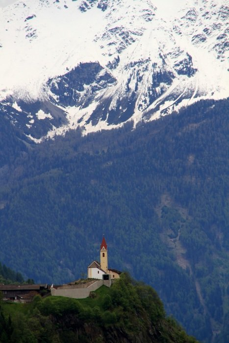 distant view of the church in the high dolomites
