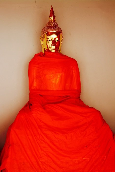 statue of buddha in red fabric