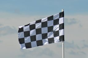 racing flag on sky background