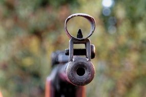 barrel of a rifle on a blurred background