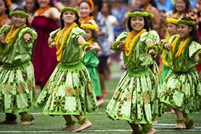 hawaiian hula dancer in green dresses