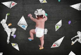 baby in diaper is climbing the wall