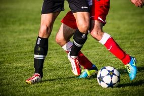 football players in boots