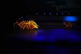 dance performance in colorful costumes on stage