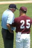 baseball player with a coach on the field