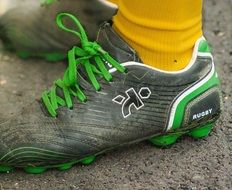 Rugby Shoes with green Laces on feet
