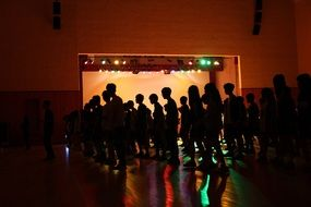 silhouettes on dance floor