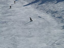 panoramic view of skiers on the track on a sunny day