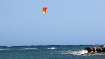bright parachute of a kiteboarder