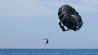 black parachute of a paraglider