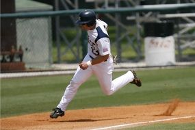 baseball player runs along the field