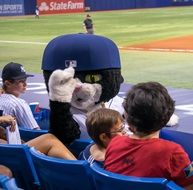 Dj Kitty, mascot for the Tampa Bay Rays Baseball team, with fans