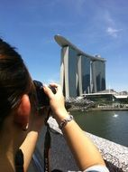 woman Photographing Marina Bay Sands hotel, Singapore