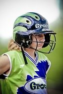 female softball player in helmet