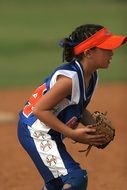 young girl playing softball
