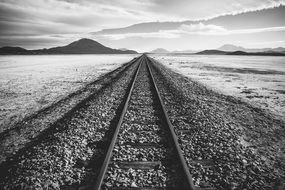 Black and white photo of the railroad tracks near the water