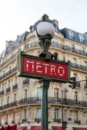 Metro sign on the street in Paris