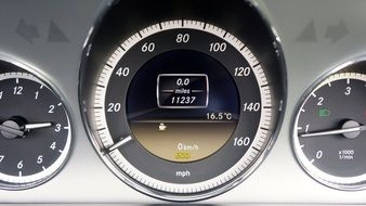 speedometer on dashboard of fast car
