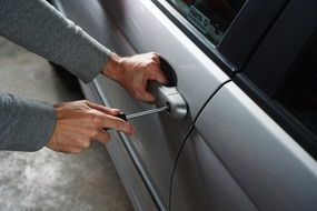 Car thief with screwdriver