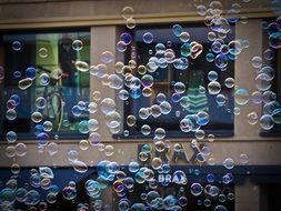 Colorful soap bubbles on a street