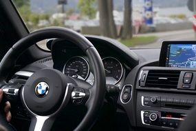 BMW car steering wheel and dashboard