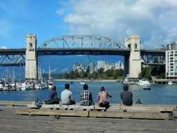 people looking at Burrard Street Bridge in cityscape, canada, Vancouver