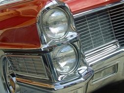 headlights of a vintage american car close-up