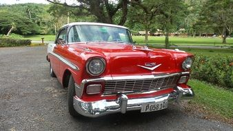 Vintage red car in the park in Cuba