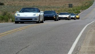 corvette cars on the road