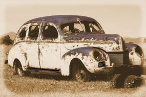 Old photo of the vintage rusty car