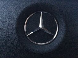 Mercedes sign on the steering wheel
