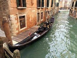 wooden gondola on a canal in Venice, Italy