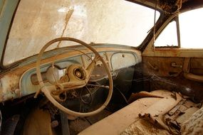 Steering wheel in the cabin of an old Renault car