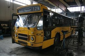 old yellow bus in a garage in the Netherlands